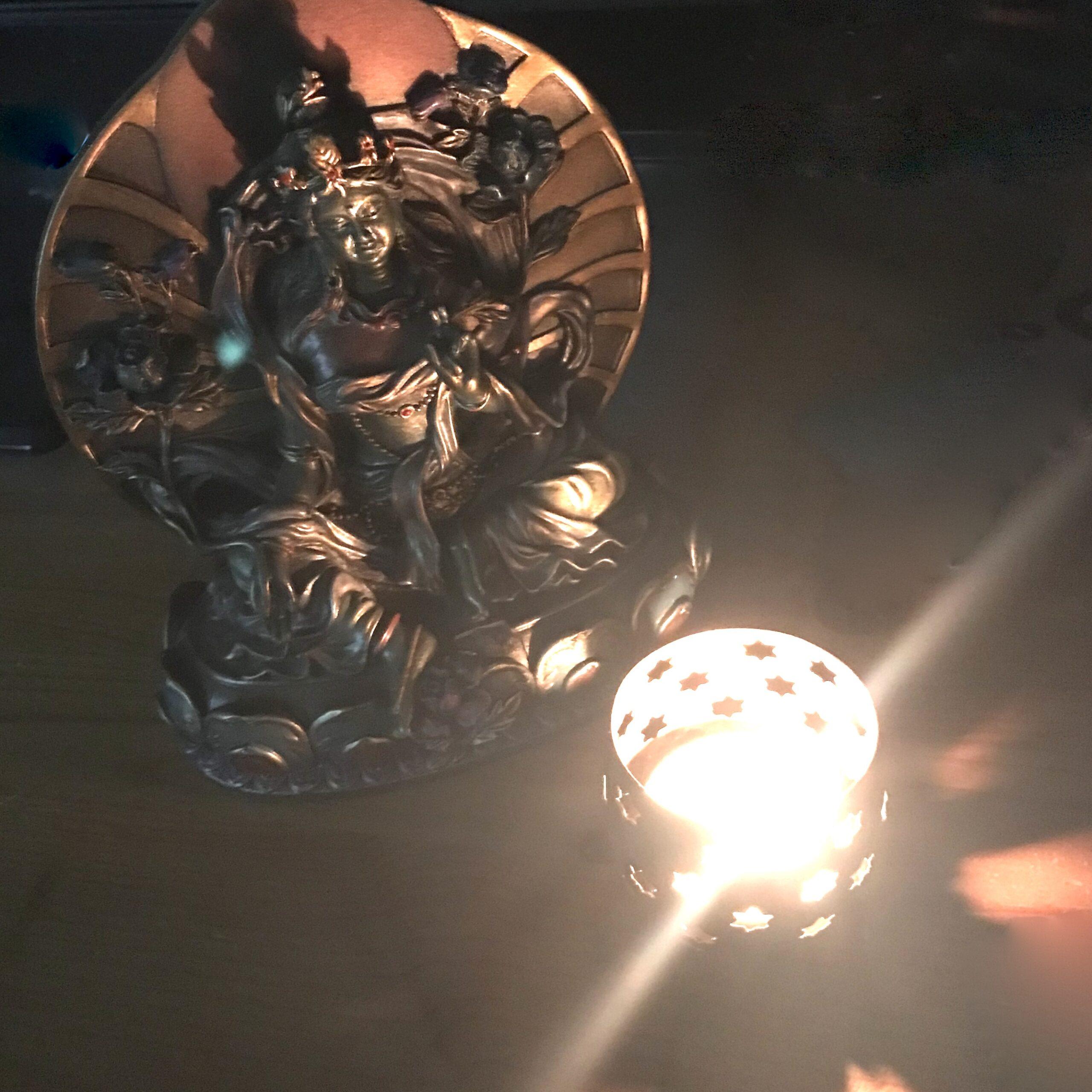 Shyamatara Murti and Candle